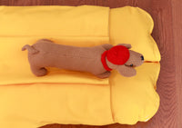 small yellow dog bed with a pocket for burrowing