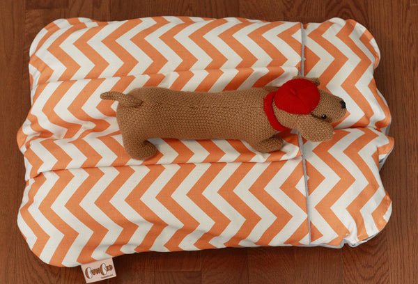 orange and white chevron dog bed with pocket for burrowing
