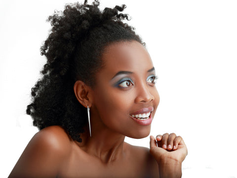 Woman with natural hair half up half down