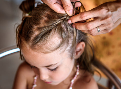 Child with thin hair getting hair braided