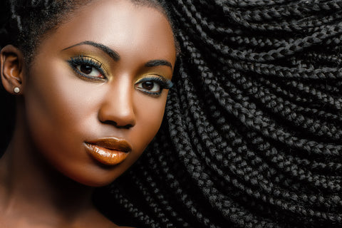 woman with long box braids