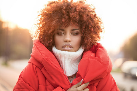 Woman with curly afro in winter gear