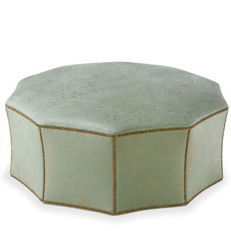 Nine scalloped sided ottoman with nail head trim.