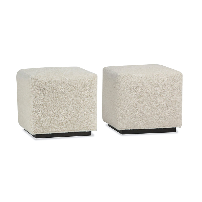 two cube benches in light colored fabric with dark base.