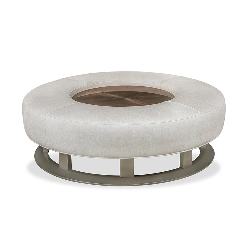 round leather ottoman with glass insert in middle.