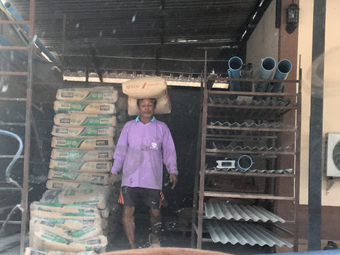 Thai Builder Carrying Cement - Irish Bootstrapper