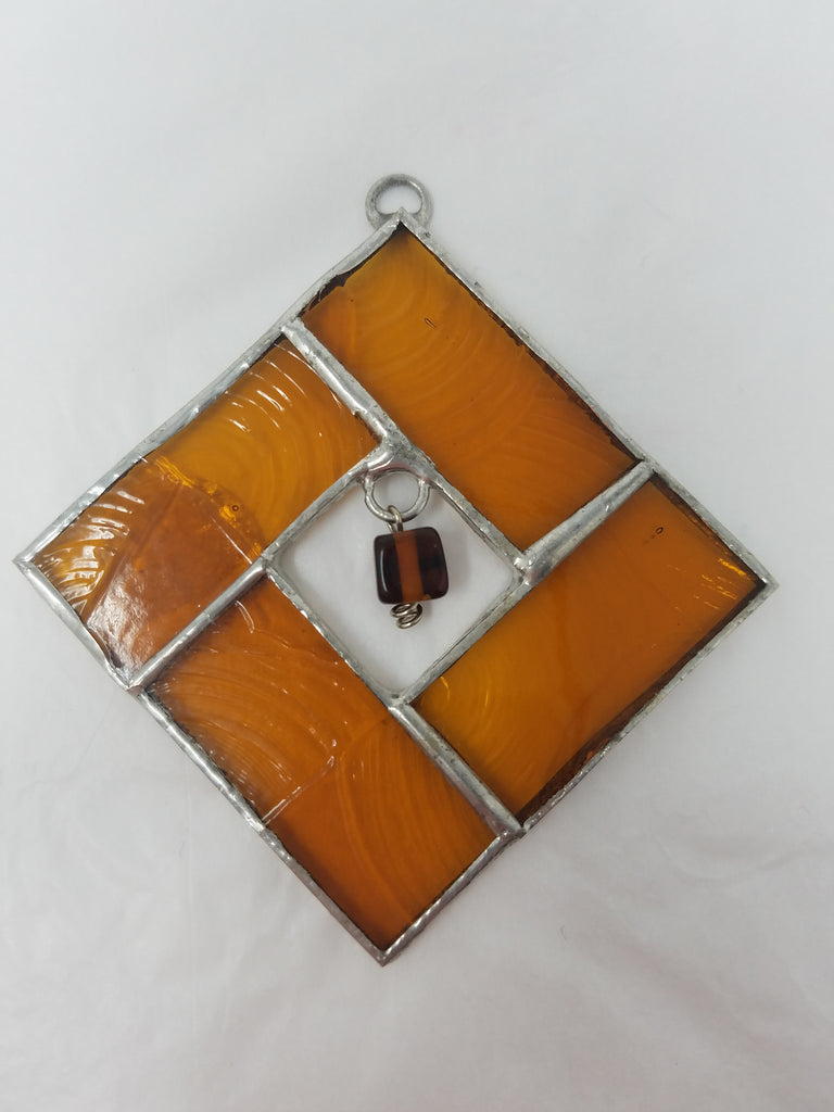 Orange beaded square glass ornament