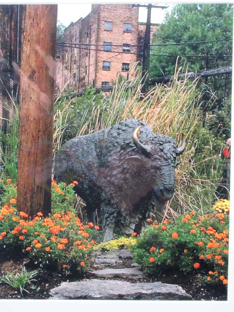 Bison Statue with Flowers