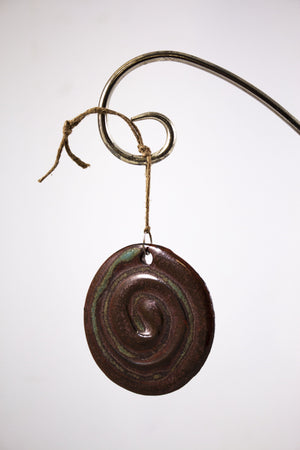 Pottery swirl ornament, flat and round, red and green