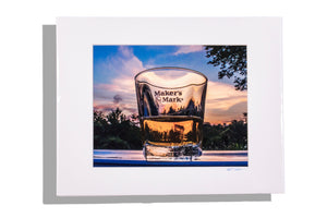 Bourbon glass, close up at sunset, color photo matted white