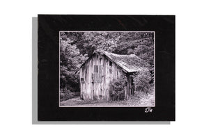 Black and white photo of old barn, U.S. flag, matted black, signed