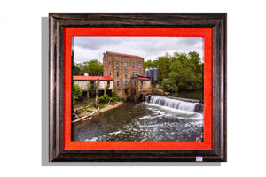 Old mill and waterfall on river, framed and matted in red burlap