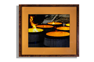 Charring bourbon barrels framed photo w brown mat
