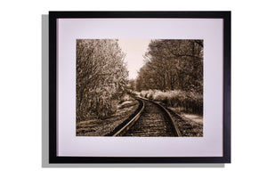 Railroad tracks to horizon framed photo w/mat by Roger Strunk