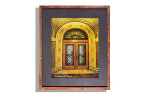 Framed color photo of ornate door, matted and signed