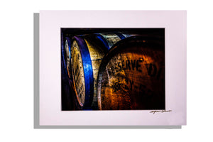 Closeup of bourbon barrels, color photo, signed, matted white