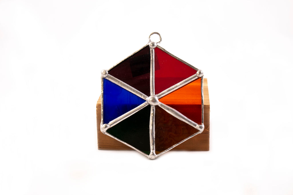 Multicolored hexagon stained glass piece