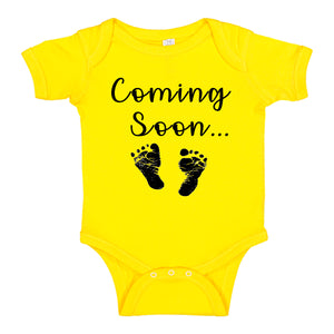 nk Trendz® Baby Coming Soon Foot Prints Pregnancy Reveal Announcement Baby Romper Bodysuit Media 1 of 13 Pregnancy reveal, baby announcement, baby shower gift Yellow Gender Neutral
