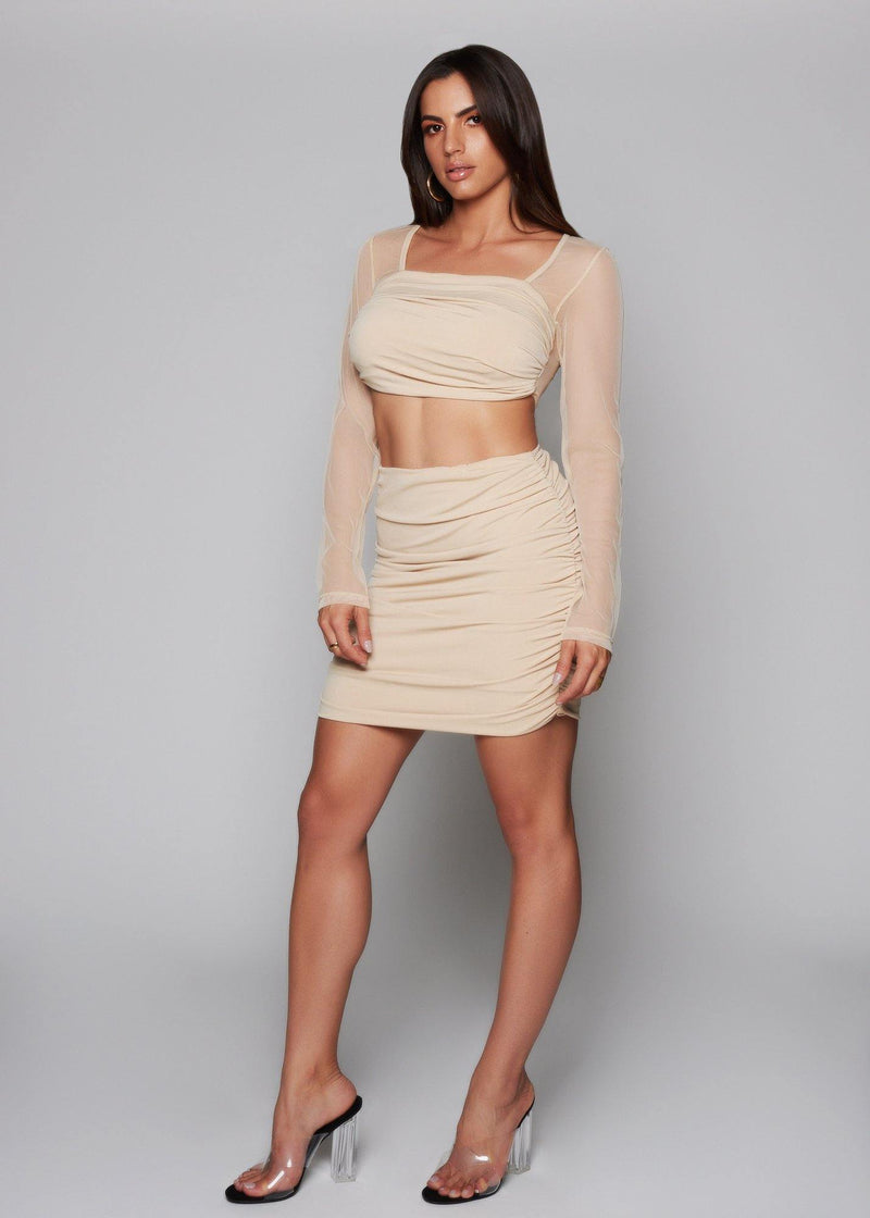 Featuring a nude mesh ruched material skirt A chic update High-waisted skirt  Stretch material  Pullover style  Summer / Casual  Part of a matching set 95% polyester 5% elastane