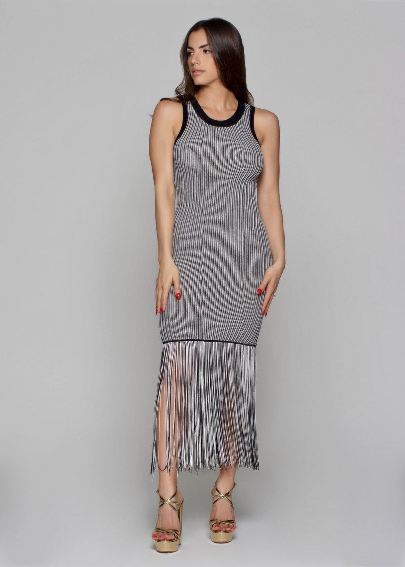 """-Add some zebra prints to your dress collection -Sleeveless  -Mini Dress -Featuring a nude zebra print color -And a floaty fit - With an adjustable waist tie  -And a midi legth  - 100%RAYON -Dry clean -Model measures: Height: 1.65, Chest: 89, Waist: 64, Hip: 92; Sample size: S/36/1"""