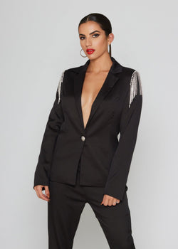 BRAND: Blithe Black long sleeve blazer V-neck blazer Part of a matching set And structured suit style With crystal detail on the shoulders Functional front bottom 100% POLYESTER Dry clean Model measures: Height: 1.65, Chest: 89, Waist: 64, Hip: 92; Sample size: S / 36/1