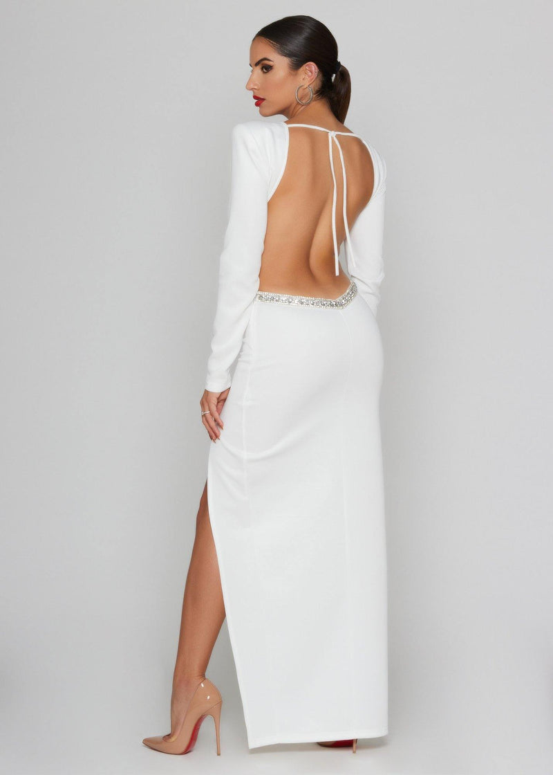 BRAND: Blithe White maxi dress with crystals details Elegant and classic. Invisible zipper -open back dress Extreme side split -long sleeve dress 100% POLYESTER -Dry clean Model measures: Height: 1.65, Chest: 89, Waist: 64, Hip: 92; Sample size: S / 36/1