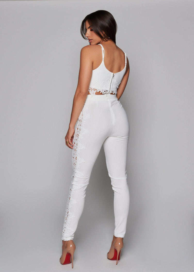 Whitetop with lace details Adjustable straps  V-neck  Crop top  Double line  With a zipper on the back Have a chic look with this top Elegant, feminine style Machine wash with cold water 95% polyester 5% spandex