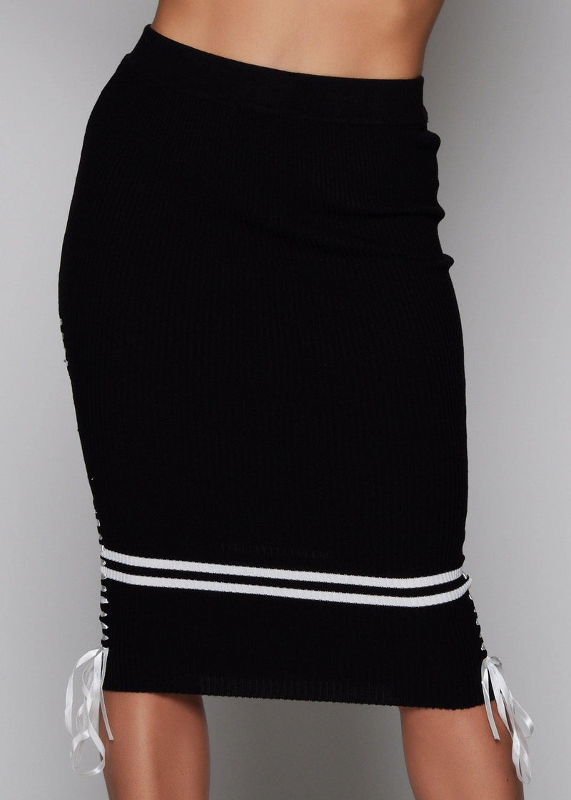 Pullover style High waist below the knee-length skirt Bandage skirt Black color with white lines detail Sexy and comfy Conforms to your curves Relaxed Machine wash with cold water 70% Rayon - 30% Nylon