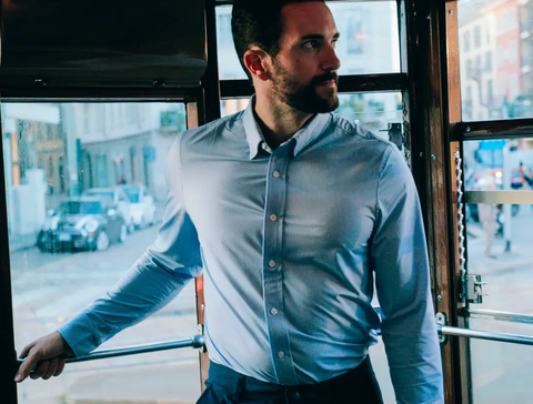 rhone commuter dress shirt with city in background