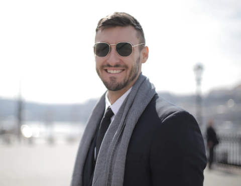 man with sunglasses and scarf