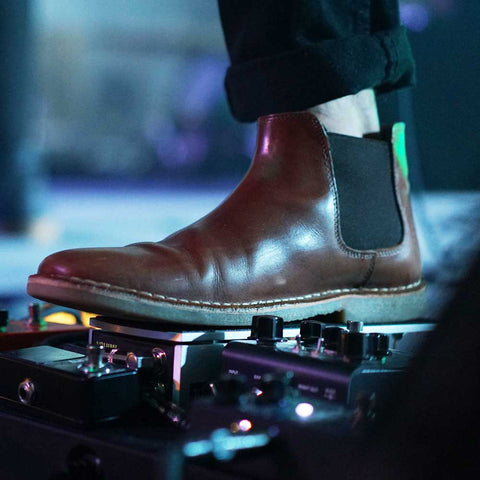 chelsea boots at rock concert close up