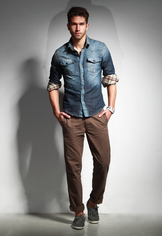 man in chinos and denim shirt