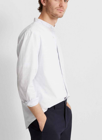 Profile view of man wearing club monaco shirt