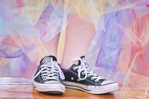converse black shoes on colorful background
