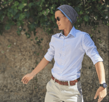 pair khakis with a beanie and dress shirt in cold weather