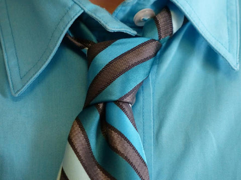 Blue shirt and striped tie