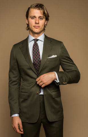 man in olive suit