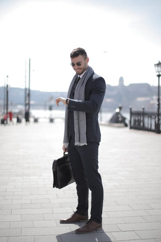 Man with scarf, briefcase and sunglasses