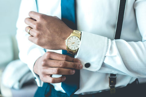 A man wearing a watch on his left hand