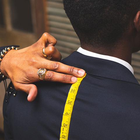 mens tailor measuring for suiting