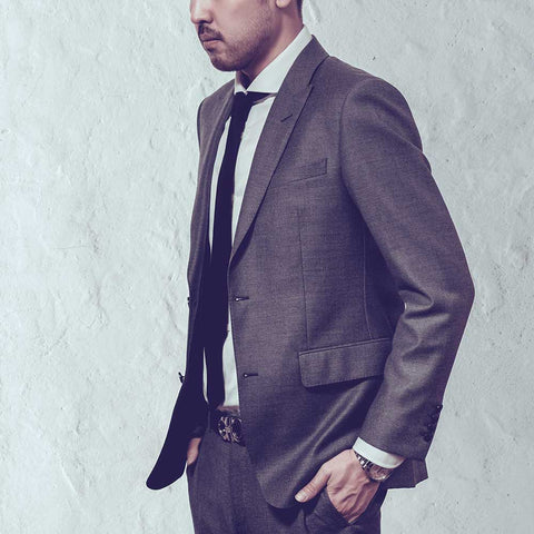 man wearing suit from profile perfect fit