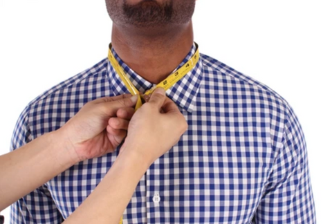 man getting neck measured