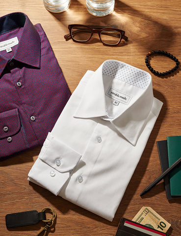 arrangement of mens shirts and accessories