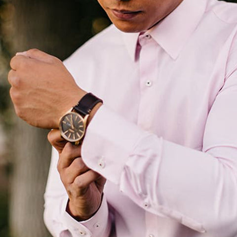 pink dress shirt sleeve length side view with watch