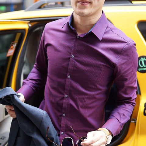 purple dress shirt being worn outside of a yellow cab