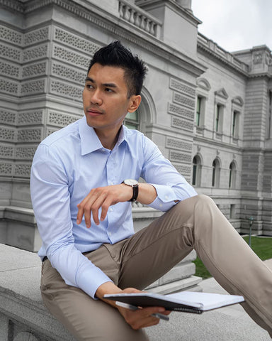 mens blue dress shirt striped sitting model with watch