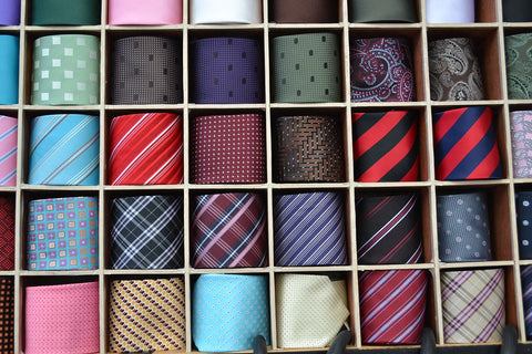 various colors and pattern ties in the box