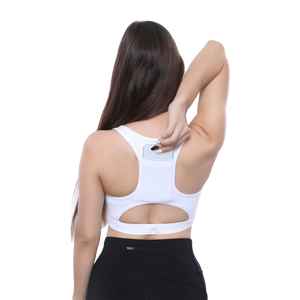 Back View PSYKIE White Reaching Phone in Back Pocket Sports Bra long line sports bra, with built-in phone holder at the back.