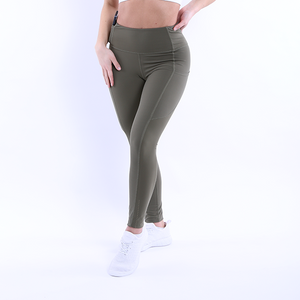 Front Crossed Legged View The Flex Leggings Navy Green colour