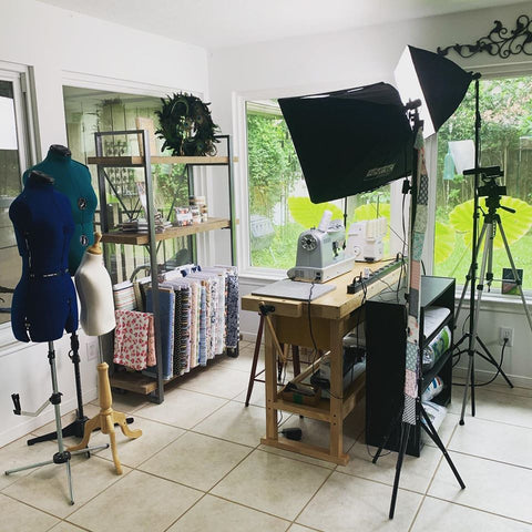 sewing area with camera and lighting rig for video production